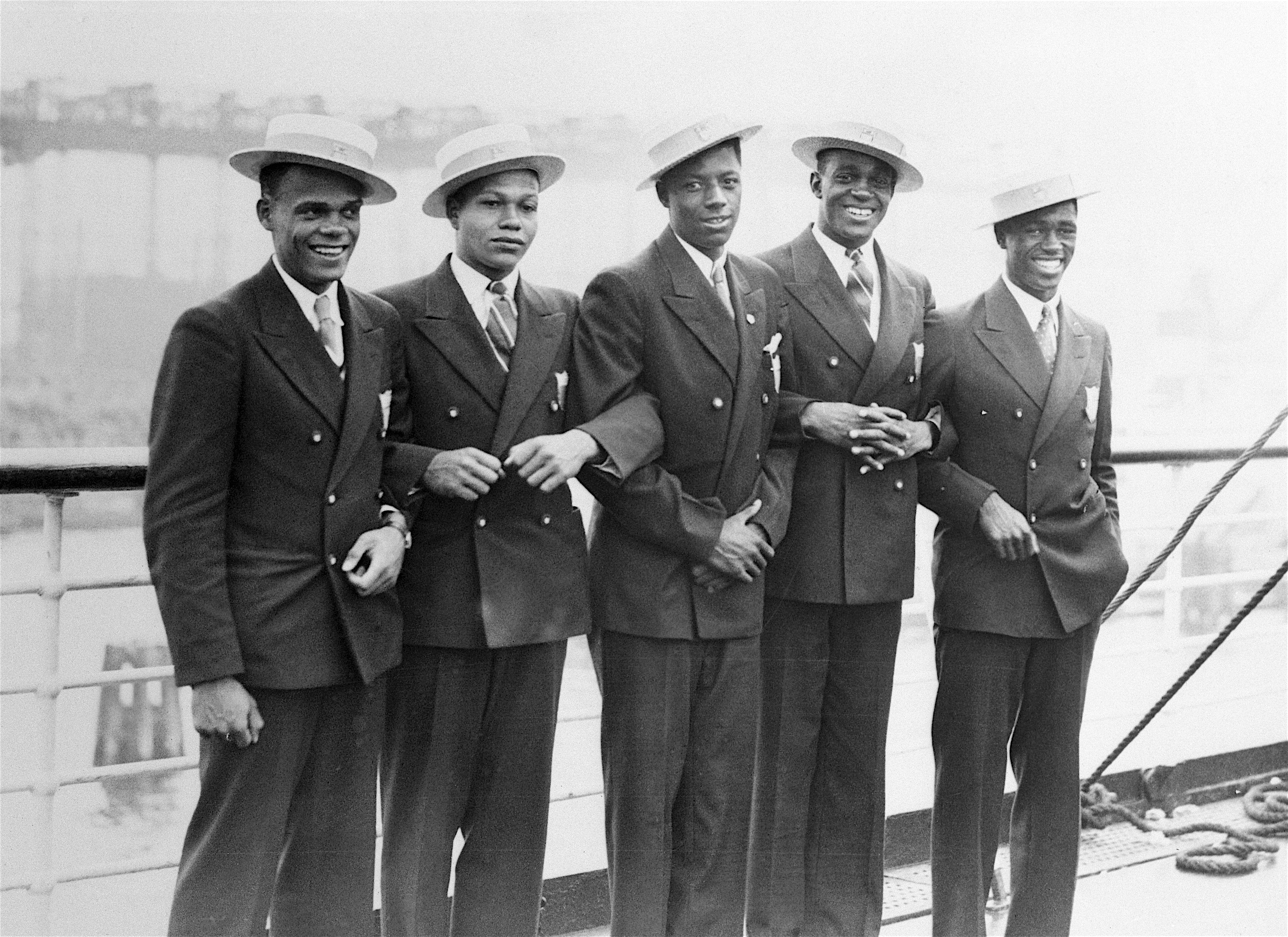 31 Jul 1936, Hamburg, Germany --- Original caption: Athletes on Uncle Sam's Olympic team are pictured aboard the S.S. Manhattan upon arrival at Hamburg. Left to right are Jimmy LuValle, Archie Williams, John Woodruff, Benjamin Johnson and Matthew Robinson. --- Image by © Bettmann/CORBIS